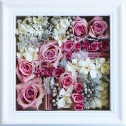 Pavé design with mixed flowers in white beaded frame